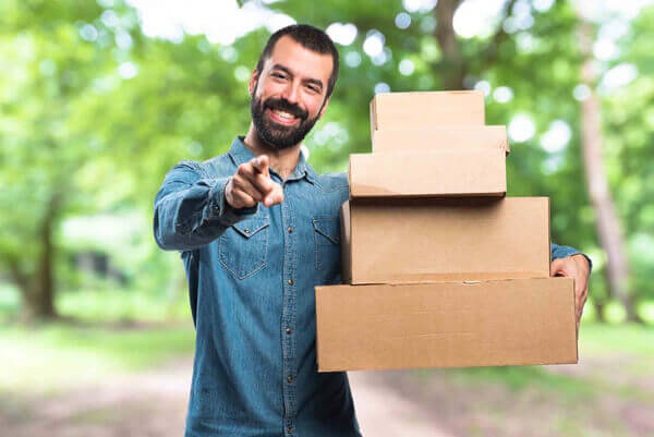 Man holding boxes on unfocused background